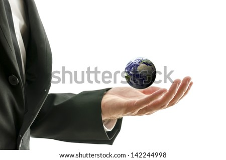 "Businessman hand holding small globe. Isolated over white background. ""Elements of this image furnished by NASA "" - stock photo"