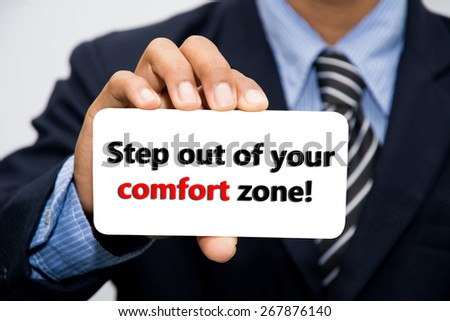 Businessman hand holding Step out of your comfort zone! concept - stock photo