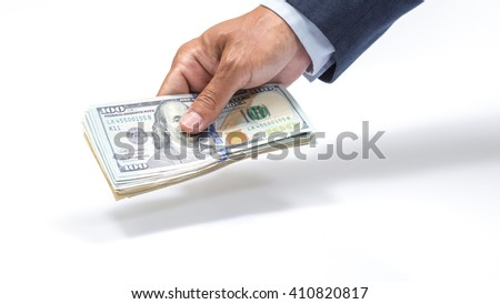 Businessman hand holding US. dollar banknote