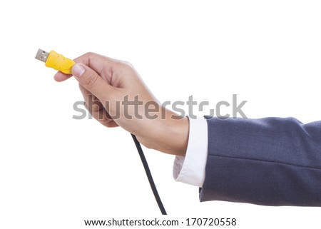 Businessman hand holding USB cable. with using path  - stock photo