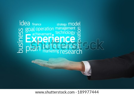 Businessman hand holding word tags of Experience - stock photo