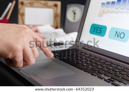 Businessman hand is about to click the mouse pad, make hisfinal decision