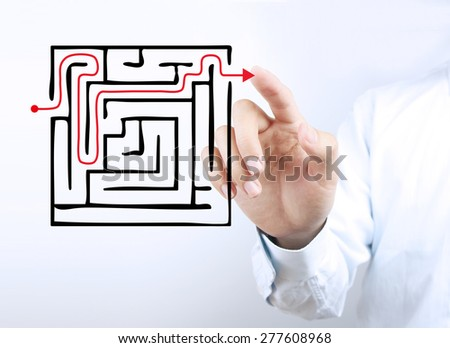 Businessman hand is pointing the solution concept on the transparent virtual screen. - stock photo