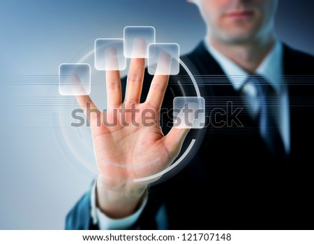 Businessman hand on a future touch screen - stock photo