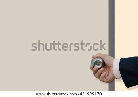 Businessman hand opening the door - stock photo