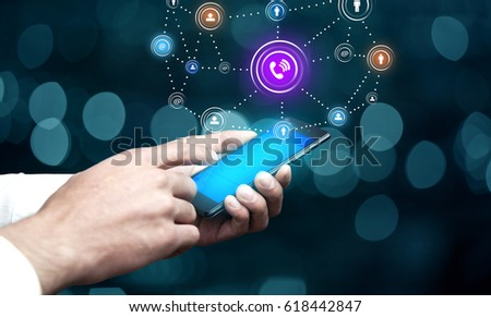 businessman hand phone with  social technology network  in screen
