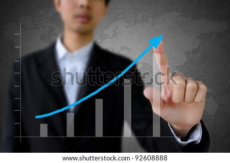 businessman hand pointing a graph.