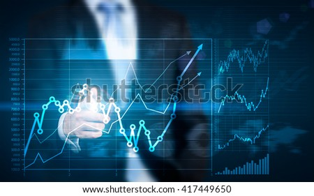 Businessman hand pointing at financial chart on blue background - stock photo