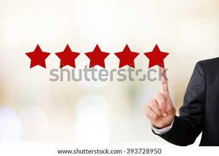Businessman hand pointing five star, customer satisfaction concept, business background - stock photo
