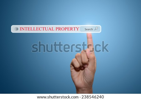 Businessman hand pointing INTELLECTUAL PROPERTYct - stock photo