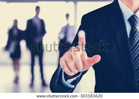 Businessman hand pointing on blank virtual screen, modern business background concept - can be used for montage your text or pictures at the finger - stock photo