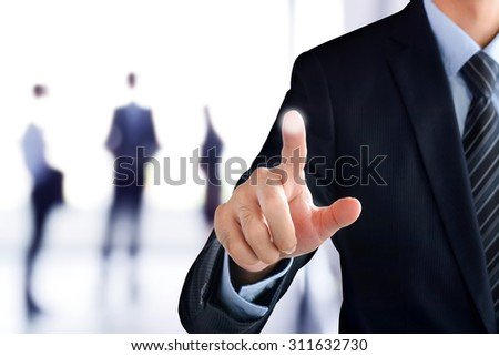 Businessman hand pointing on empty virtual screen, modern business user interface (UI) background concept - stock photo