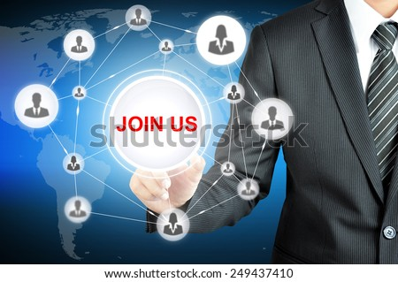 Businessman hand pointing on JOIN US sign on virtual screen with human icons linked as network - stock photo