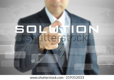 Businessman hand pointing on SOLUTION word on virtual screen