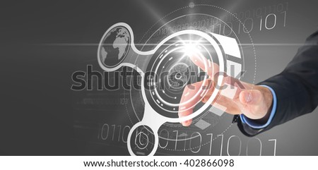 Businessman hand pointing something against interface - stock photo