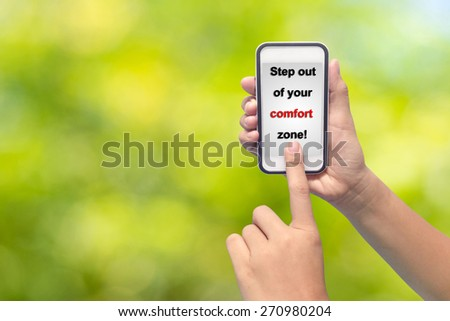 Businessman hand pointing Step out of your comfort zone! - stock photo