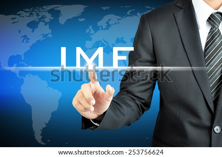 Businessman hand pointing to IMF (International Monetary Fund) sign on virtual screen
