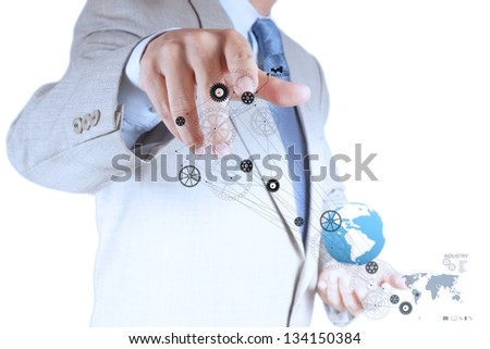 businessman hand points gear to success as concept - stock photo