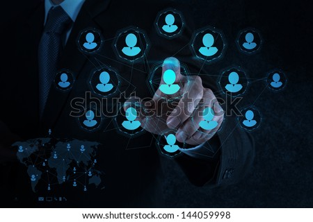 businessman hand points human resources, CRM and social media as concept - stock photo