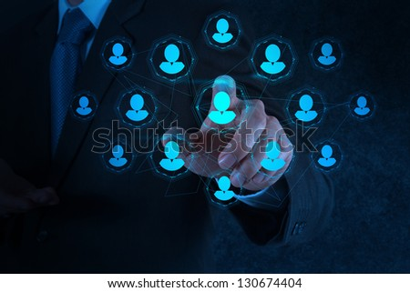 businessman hand points the human resources, CRM and social media diagram as concept - stock photo