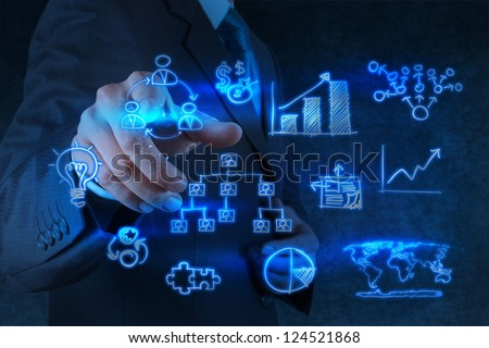 businessman hand points to business strategy as concept - stock photo