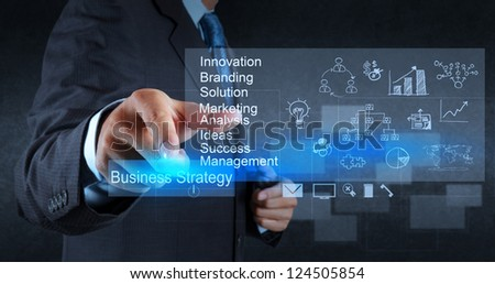businessman hand points to business strategy diagram as concept - stock photo