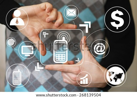 Businessman hand press telephone button virtual - stock photo