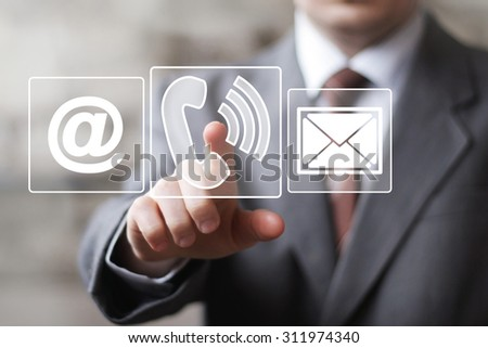 Businessman hand press telephone online button icon - stock photo