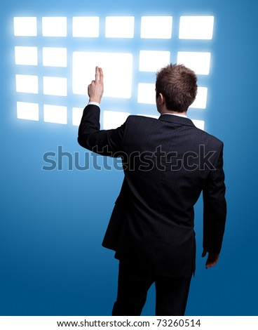 Businessman hand pressing digital button - stock photo