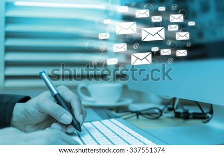 Businessman hand pressing the keyboard for sending the e-mail from computer, business technology concept - stock photo