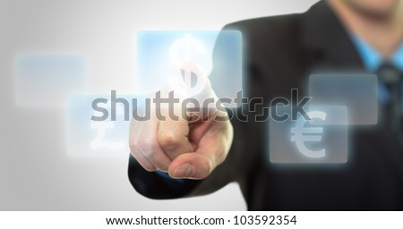 Businessman hand pressing virtual dollar sign button - stock photo