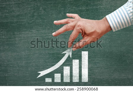 businessman hand pulling increase index arrow - stock photo
