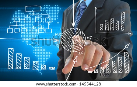 businessman hand pushing a business graph on a touch screen interface - stock photo