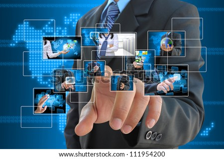businessman hand pushing a button streaming images on a touch screen interface - stock photo