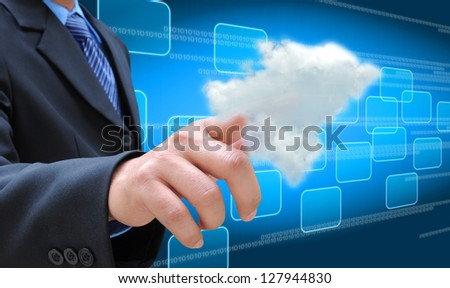 businessman hand pushing a cloud on a touch screen interface
