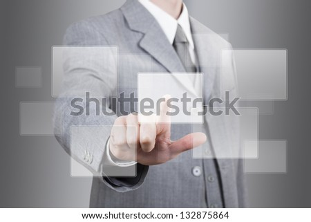 businessman hand pushing an empty touch screen - stock photo