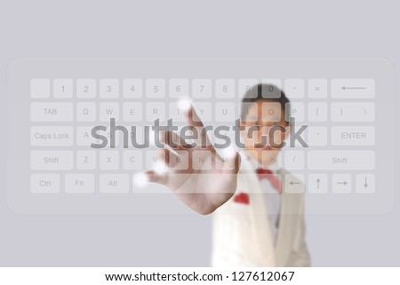 Businessman hand pushing button on a touch screen computer keyboard