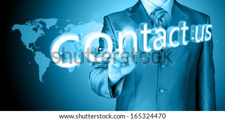 businessman hand pushing contact us button on a touch screen interface - stock photo