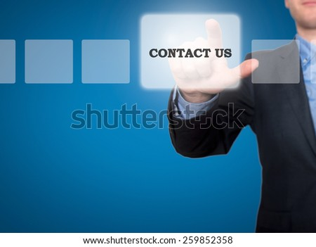 Businessman hand pushing contact us button on a touch screen interface. Blue - Stock Photo - stock photo