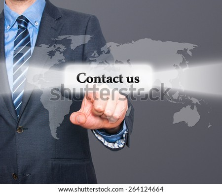businessman hand pushing contact us button on a touch screen interface. Isolated on grey background. Stock Photo - stock photo