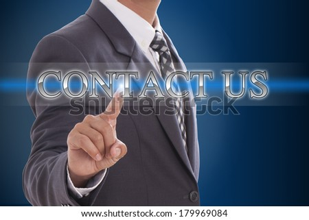 Businessman hand pushing contact us button on virtual screens - stock photo