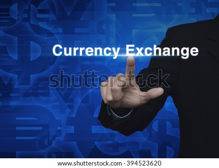 Businessman hand pushing currency exchange word on blue currency background