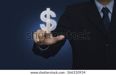 Businessman hand pushing dollar currency icon over blue background