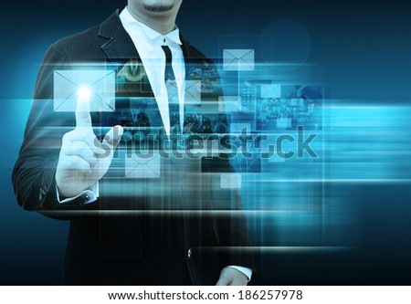 Businessman Hand pushing letter sign
