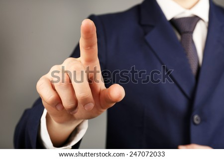 Businessman hand pushing screen, close-up