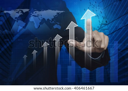 Businessman hand pushing white arrow head over map, graph and city tower, Success concept, Elements of this image furnished by NASA