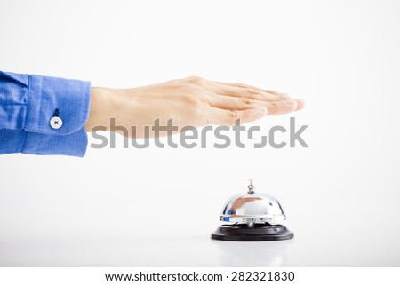 Businessman hand ringing the bell for assistance