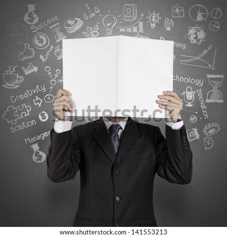 businessman hand show black cover book of success business as concept