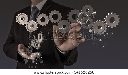businessman hand show gear to success as concept - stock photo