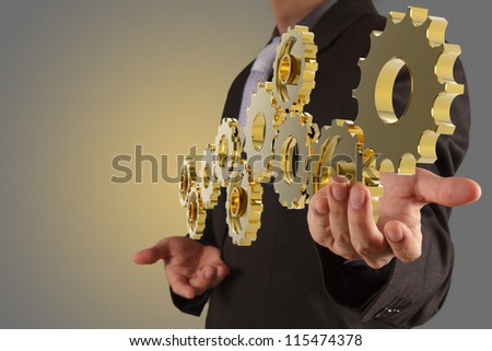 businessman hand show golden gear to success as concept - stock photo